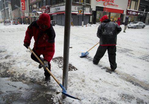 Workers Shovel Snow at an Intersection in New York