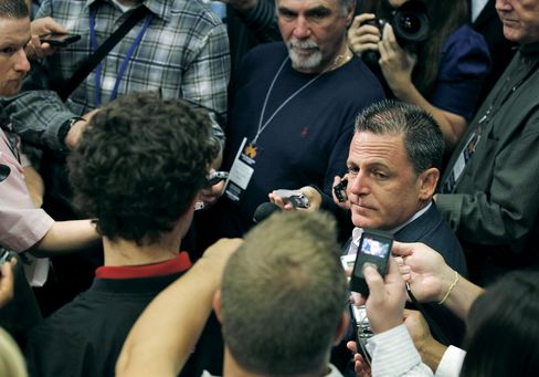 Majority owner Dan Gilbert of the Cleveland Cavaliers talks to the media prior to playing the Boston Celtics in the Cavaliers 2010 home opener at Quicken Loans Arena on Oct. 27, 2010 in Cleveland, Ohio. Photographer: Gregory Shamus/Getty Images