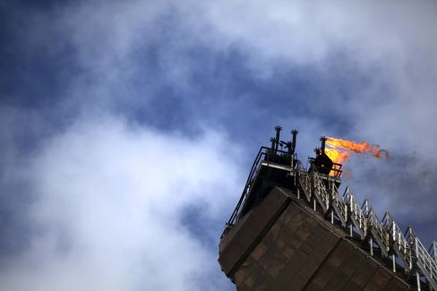 A flare burns atop Petroleo Brasileiro SA's P-51 oil platform in the Marlim Sul field, at the Campos Basin, about 150 kilometers off the coast of the state of Rio de Janeiro, Brazil. Photographer: Rich Press/Bloomberg