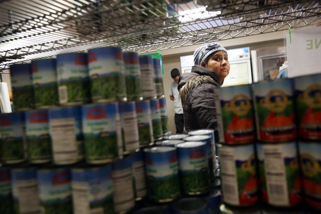 A Harlem resident chooses groceries at a food bank in New York City. Photographer: John Moore/Getty Images