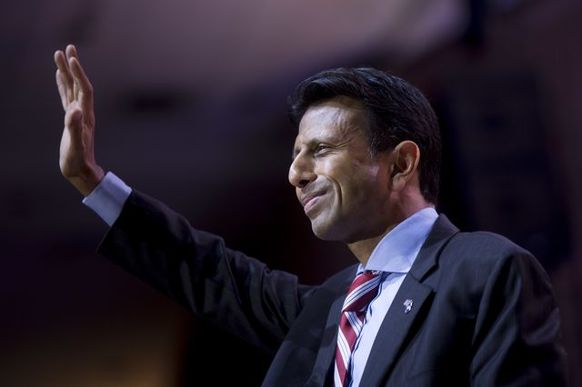 Bobby Jindal raises his hand to help reform health care. Photographer: Andrew Harrer/Bloomberg
