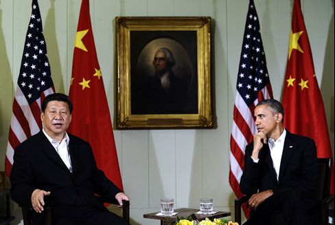 U.S. President Barack Obama listens as Chinese President Xi Jinping answers a question following their bilateral meeting in Rancho Mirage, California, on June 7, 2013. Photographer: Jewel Samad/AFP via Getty Images