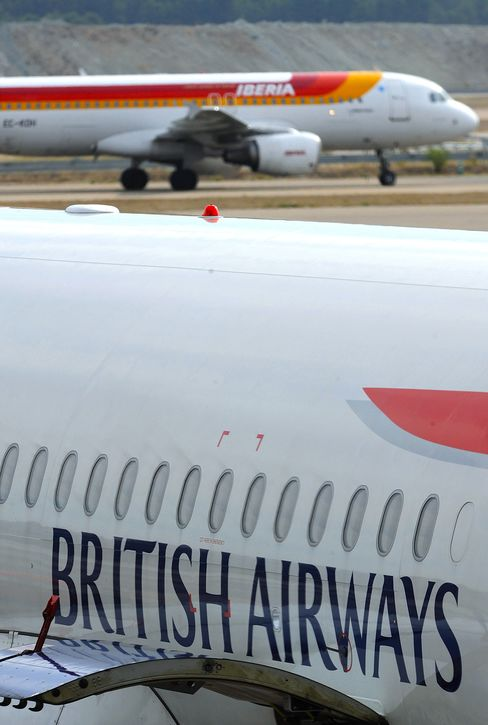 A British Airways and Iberia airplane taxi