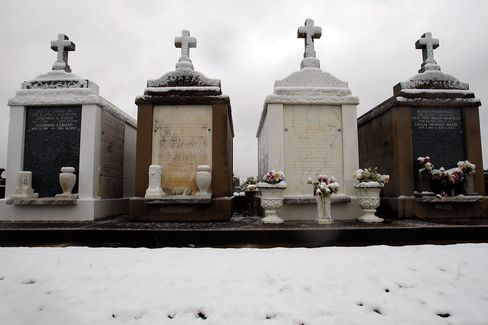 Snow collects on above ground tombs in a cemetary in New Orleans. Photographer: Chris Graythen/Getty Images