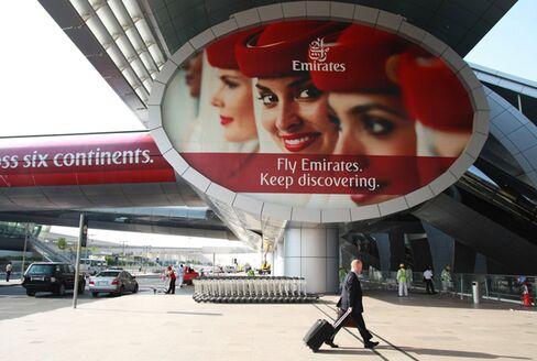 A Passenger Enters Dubai International Airport Departures Hall