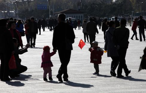 A Child Holds a Chinese National Flag in Tiananmen Square