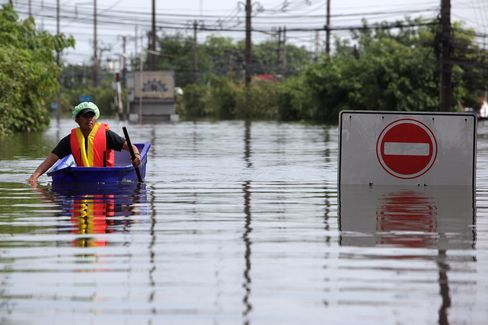 Floodwaters have swept across 60 of Thailand's 77 provinces