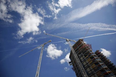 Cranes Stand near a Residential Apartment Block in London