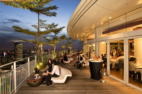 The terrace and dining room at Sky on 57 in Singapore. Justin Quek's restaurant is on top of the Marina Bay Sands Hotel. Source: Marina Bay Sands via Bloomberg
