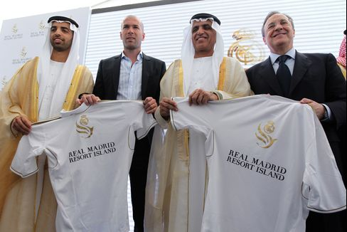 From left to right, Emirati Crown Prince of Ras al-Khaimah Mohammed bin Saud, former French football star and Real Madrid sports director Zinedine Zidane, ruler of Ras al-Khaimah Sheikh Saud bin Saqr al-Qassimi and Real Madrid president Florentino Perez pose for a picture during a press conference to unveil the one-billion-dollar Real Madrid Resort them