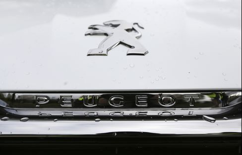 A Logo Sits on the Hood of a Peugeot 308 Automobile