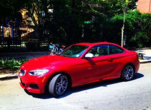 The M235i includes xenon headlights, hands-free Bluetooth and USB, and dynamic brake and stability control, all as standard features.