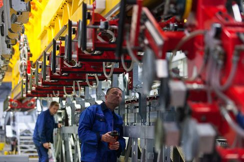 Employees Work on Production at a Factory in Hamburg