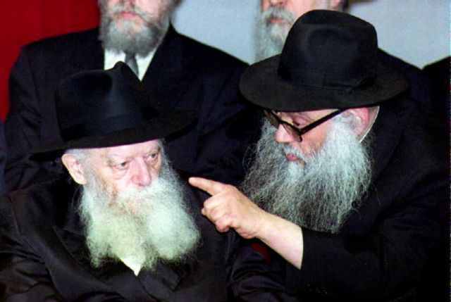 Rabbi Menachem Mendel Schneerson, left, in 1993.