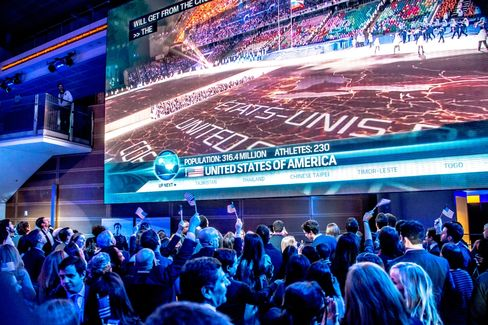 Comcast took over the giant Newseum on Pennsylvania Avenue for the Sochi Olympics kickoff party where 700 guests, including a top White House official, watched the ceremonies on a mammoth screen. Photographer: Daniel Swartz/Revamp DC via Bloomberg