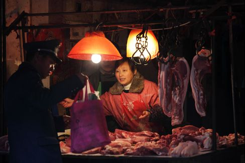 China Inflation Over 3.5% May Prompt Rate Rise, NDRC's Chen Says