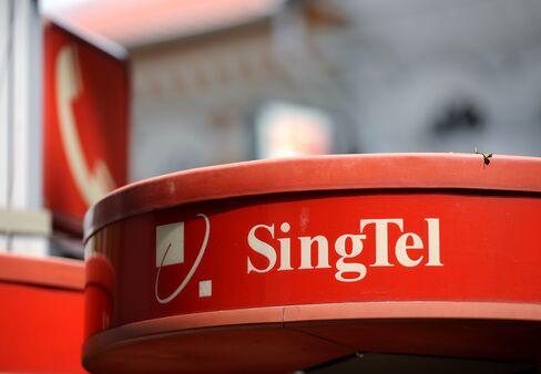 SingTel Profit Drops 8.3% on Optus Restructure, Globe Charge
