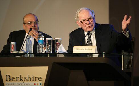 Jain Takes Challenge to Make Buffett Look Like Idiot