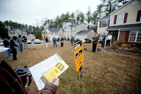 A potential bidder during a real estate auction in Atlanta. Photographer: Chris Rank/Bloomberg