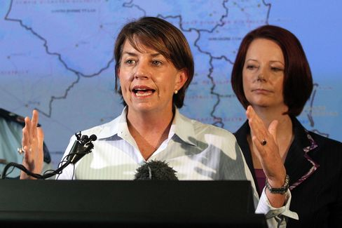 Australia Looks to Bligh Who Cries for Flooded Queensland