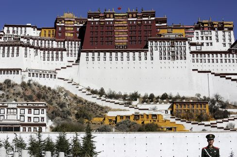 A paramilitary policeman stands guard in front of the Potala Palace.