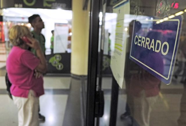 Venezuelans at the airport found boarding gates closed. Photographer: Juan Barreto/AFP/Getty Images