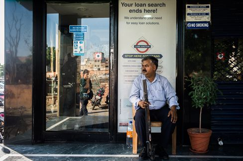 A guard sits outside a Housing Development Finance Corp. (HDFC) bank branch in Jaipur, Rajasthan, India.  Photograph: Sanjit Das/Bloomberg