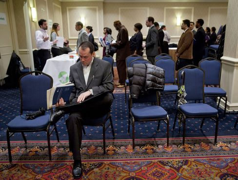 For 13 million out-of-work Americans, record spells of joblessness are abating. Photographer: Jin Lee/Bloomberg