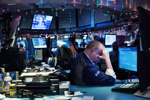 A trader works on the floor of the New York Stock Exchange during the afternoon of Jan. 4, 2016 in New York City.
