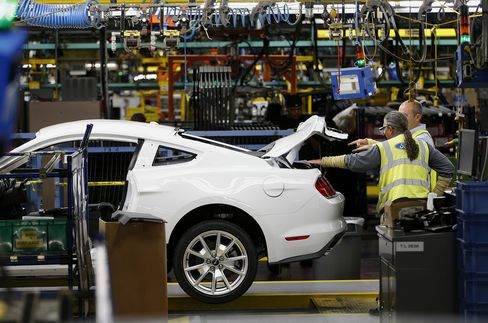 Employees Inspect a Ford Motor Co. 2015 Mustang