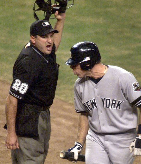 Umpire Mark Hirschbeck, left, calls out Scott Brosius of the New York Yankees at  home plate . Photographer: Jed Jacobsohn/Allsport