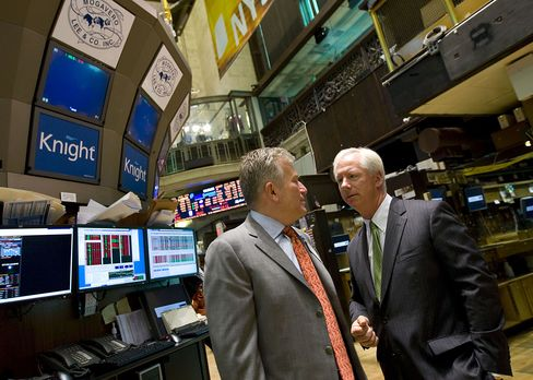 Duncan Niederauer, chief executive officer of chief executive officer of NYSE Euronext, left, and Thomas M. Joyce, chairman and chief executive officer of Knight Capital Group Inc., tour the floor of the New York Stock Exchange. Photographer: Jin Lee/Bloomberg