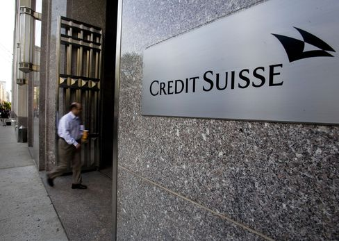 A man walks into the Credit Suisse Group AG office in New York. Photographer: Jin Lee/Bloomberg News.