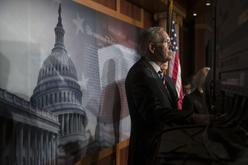 Senator Harry Reid, a Democrat from Nevada and Senate majority leader, listens during a news conference following a vote in Washington, D.C. on Sept. 27, 2013. Photographer: Andrew Harrer/Bloomberg