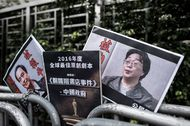 Placards showing missing bookseller Lee Bo and Gui Minhai.