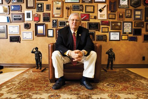 William Janklow, former governor of South Dakota, poses in his law office crowded with mementos from his 16 years as a Republican governor, in Sioux Falls on March 24, 2009.  Photographer: Thomas Strand/Bloomberg Markets via Bloomberg