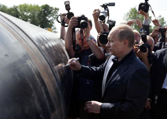 Yes, he is autographing a pipeline. Photographer: Alexey Druzhinin/AFP/Getty Images