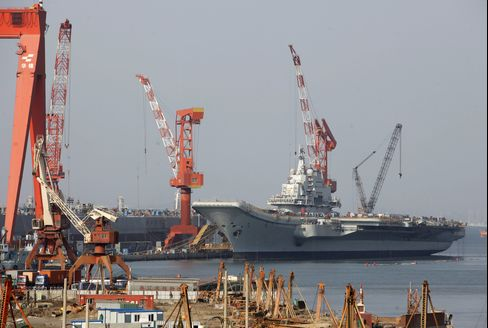 The Varyag, a Russian built aircraft carrier sits docked in Dalian, Liaonin Province, China. Photographer: Qilai Shen/Bloomberg