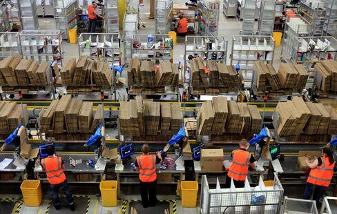 Amazon Speeds Warehouse Spending Amid EBay Delivery Threat