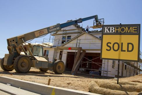 A sold sign sits in front of homes under construction by developer KB Home in Valencia, California, U.S. The number of households comprising three generations increased to almost 5.1 million in 2010 from 3.9 million a decade earlier, according to the Census Bureau. Photographer: Jonathan Alcorn/Bloomberg