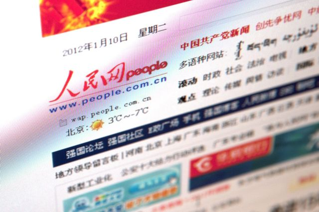 The People's Daily Online Co. Ltd. website is displayed on a computer in Beijing, China. Photographer: Nelson Ching/Bloomberg