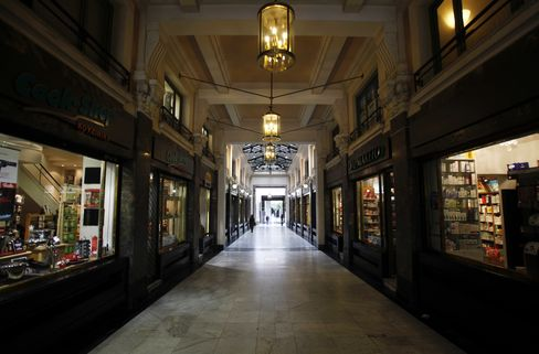 An empty shopping arcade in central Athens. Photographer: Kostas Tsironis/Bloomberg