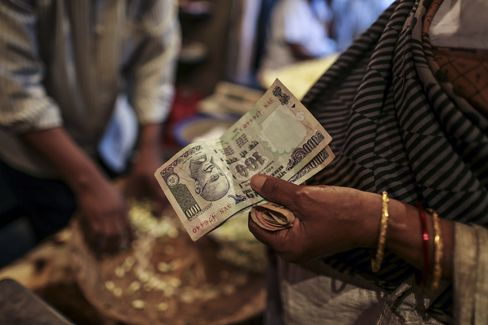 India's Rupee Plunges to Record on Fed Concern; Bonds Decline