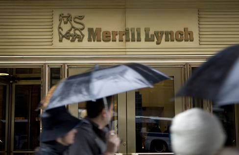 Pedestrians walk past the Merrill Lynch & Co. headquarters in New York. Photographer: Andrew Harrer/Bloomberg News