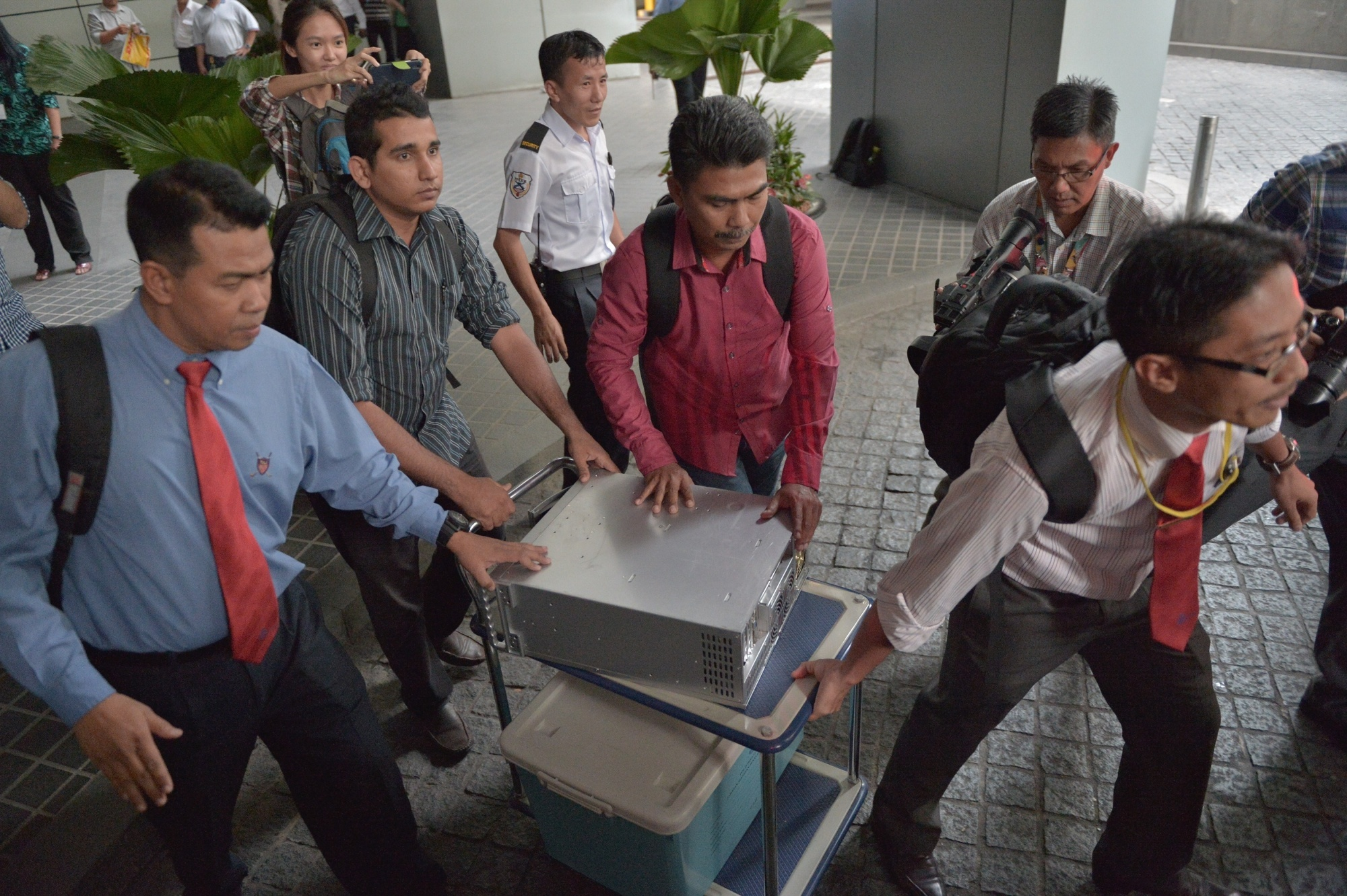 Malaysian police seize equipment from the 1MDB office in Kuala Lumpur in July 2015.