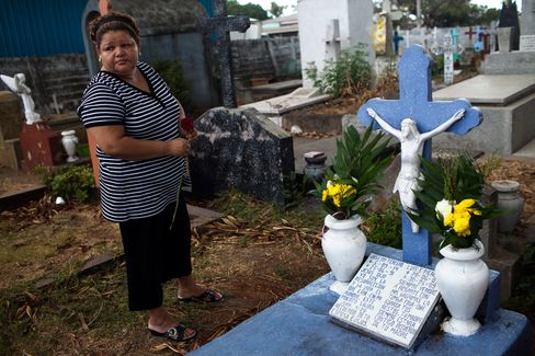 Elisabeth Tercero visits the grave of her son, Luis Picado, on March 16, 2011 in Managua, Nicaragua.  Photographer: David Rochkind/Bloomberg Markets via Bloomberg