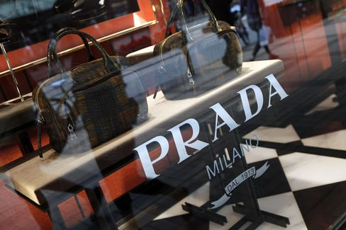 Handbags are displayed in the window of a Prada SpA store