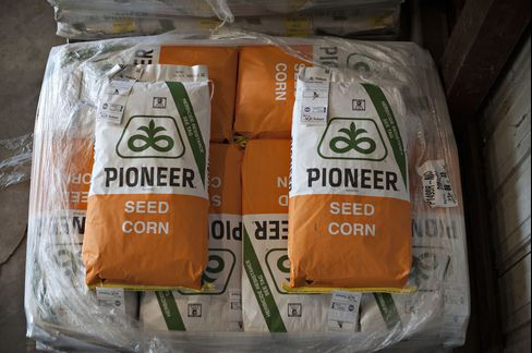 Bags of DuPont Co. Pioneer Brand Seed Corn Sit at a Farm