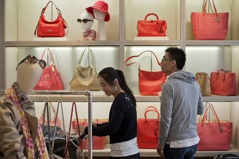 Customers Browse at a Coach Inc. Store in New York