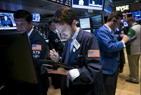 Stocks Fall With Bonds, Commodities on BOJ Stance as Yen Rallies